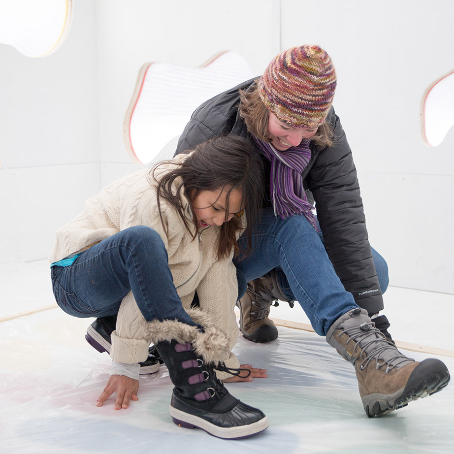 An adult and child, crouched down playing twister