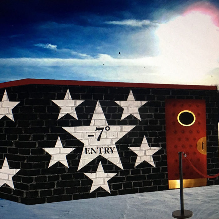 a shanty with black walls, stars and red door