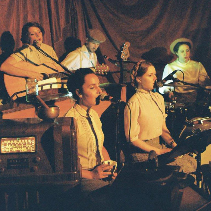 Photo of a group of 5 people playing music