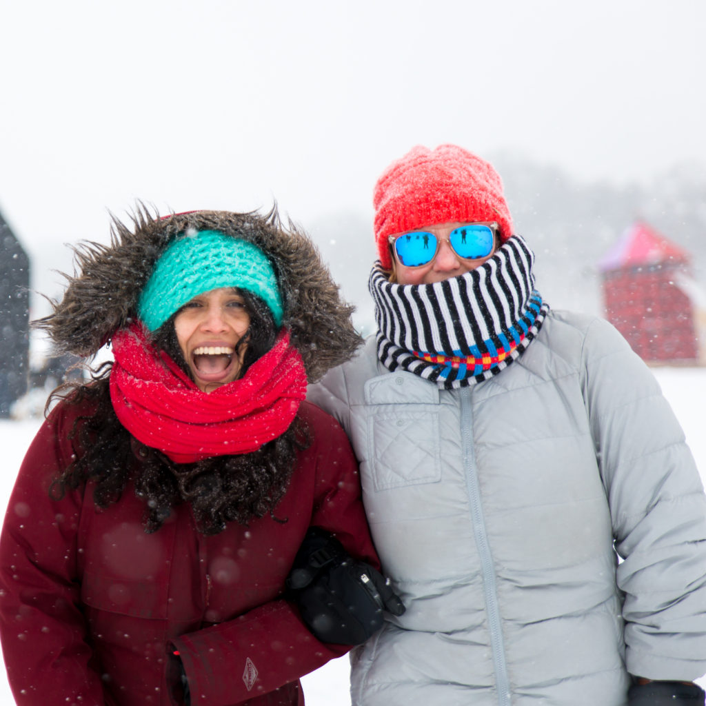 2 people bundled up in winter gear in the snow