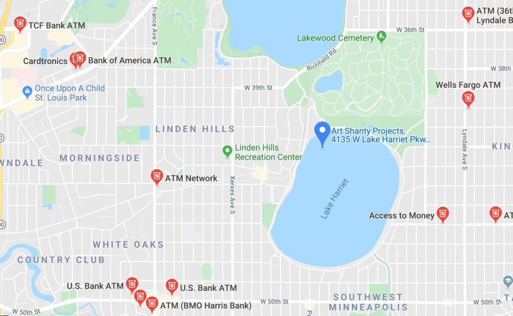 A screen shot of a map, depicting the location of the Art Shanty Projects. A blue marker indicates Art Shanty Projects on the northwestern part of Lake Harriet (Bde Unma). There are also red markers indicating ATMs and banks.