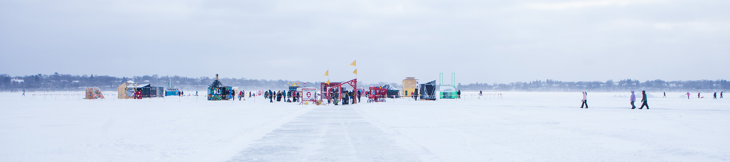 Horizon shot of the art shanty village on the frozen lake